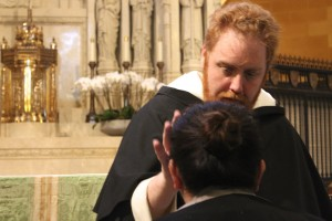 Fr Michael administering the Anointing of the Sick during the Lourdes Novena healing retreat last year